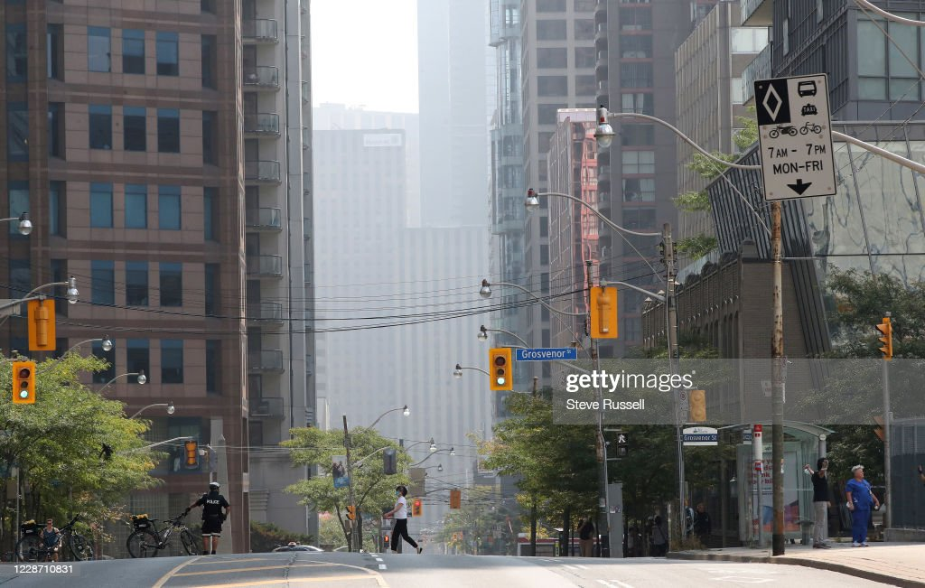 Climate activists blocked off the Bay and Wellesley intersection in downtown Toronto this afternoon to hold a socially distanced sit-in and demand immediate action on climate change. : News Photo