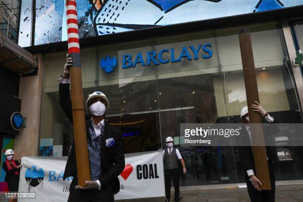 Climate activists from Fund our Future and Fossil Free London campaigns TKTK outside a Barclays Plc bank branch in Piccadilly in London UK on...