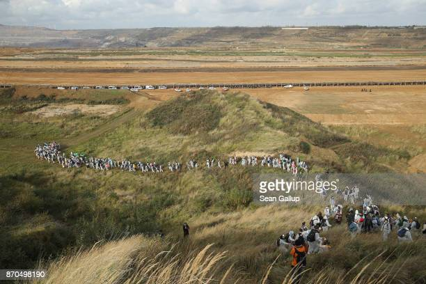 Climate activists from the group 'Ende Gelaende' descend into the Hambach openpit coal mine during a protest march on November 5 2017 near Manheim...