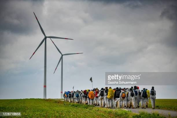 Climate activists march in an attempt to occupy the Garzweiler open-cast coal mine and nearby gas infrastructure on a day of civil disobedience...