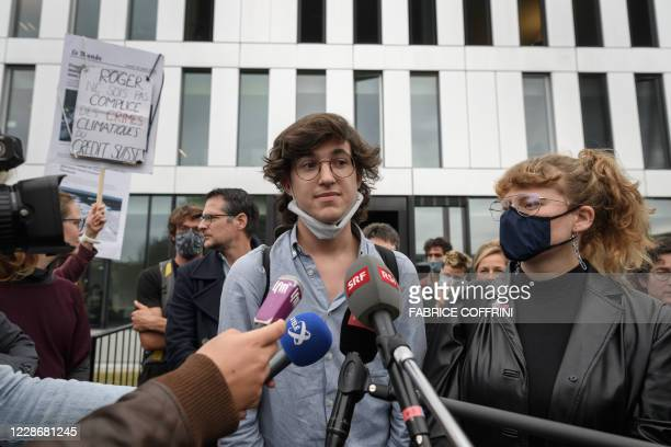 Climate activists Paul Castelain and Claire Corbaz react on September 24 2020 in Renens near Lausanne after the verdict of an appeal by the canton...
