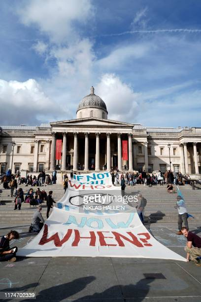 Climate activists protest on the steps of the National Gallery in Trafalgar Square during the third day of climate change demonstrations by the...