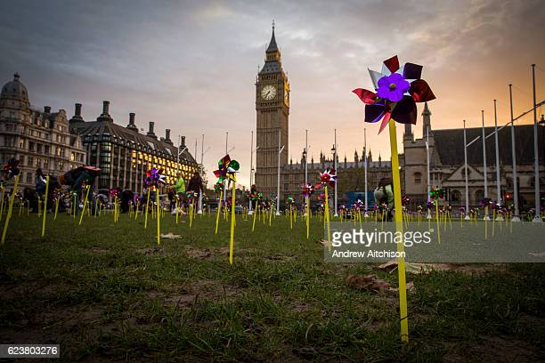 10 covered Parliament square outside the Houses of Commons with over 1000 whirling pin wheels highlighting public support for onshore wind power on...