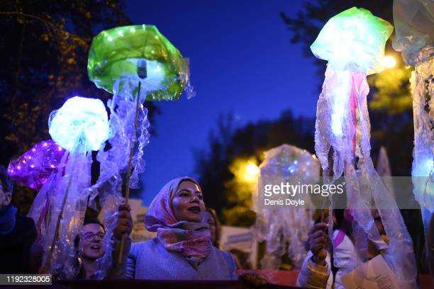 A climate change activist marches in the 'Fridays For Future' climate change mass protest on December 6 2019 in Madrid Spain Activists from all over...