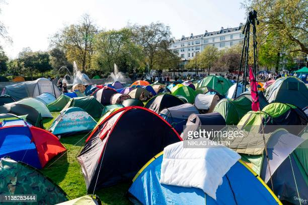 Climate change activists are pictured at their encampment at Marble Arch in London on April 20 the sixth day of an environmental protest by the...