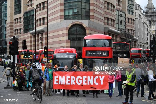 Climate change activists block traffic by Threadneedle street in central London during environmental protests by the Extinction Rebellion group in...