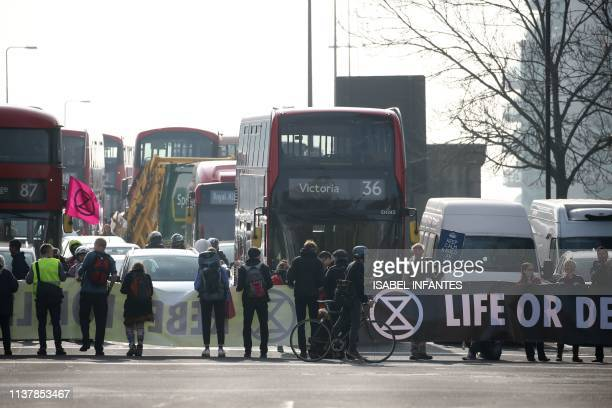 Climate change activists block traffic on Vauxhall Bridge in London on April 18 2019 as an environmental protest by the Extinction Rebellion group...
