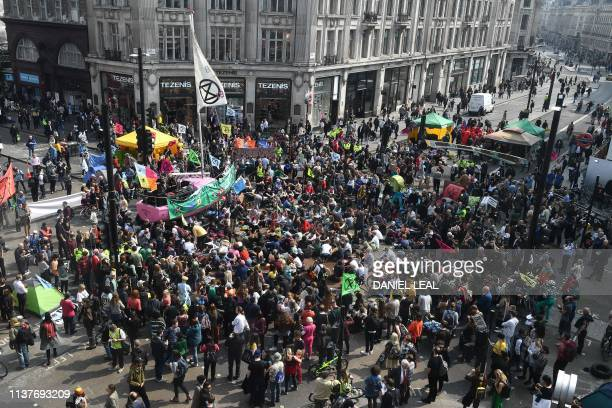 Climate change activists blockade Oxford Circus on the third day of an environmental protest by the Extinction Rebellion group in London on April 17...
