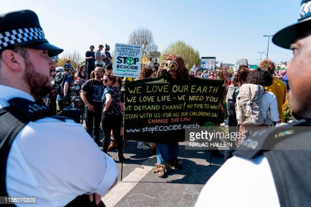 Climate change activists continue to block the road on Waterloo Bridge in London on April 20 on the sixth day of an environmental protest by the...