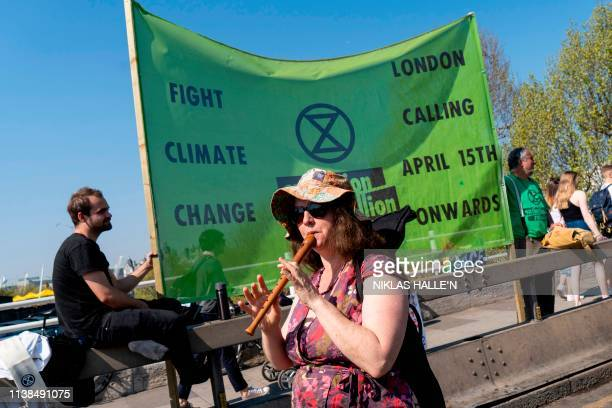 Climate change activists continue to block the road on Waterloo Bridge in London on April 21 on the seventh day of an environmental protest by the...