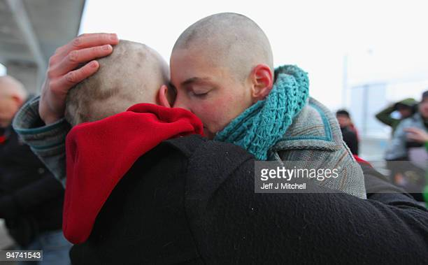 Climate change activists embrace after shaving their heads in protest against the UN Climate Change Conference on December 18 2009 in Copenhagen...