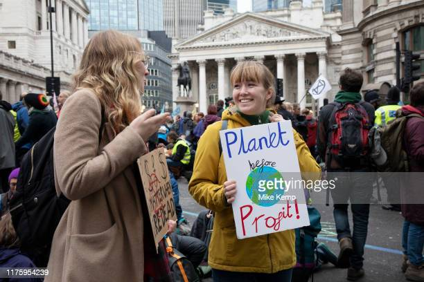 Climate change activists from Extinction Rebellion block the streets at Bank in the heart of the City of London financial district on 14th October...