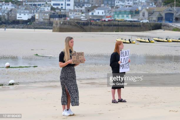 Climate change activists from Extinction Rebellion standing in solidarity with the world wide protest, Black Lives Matter following the death of...