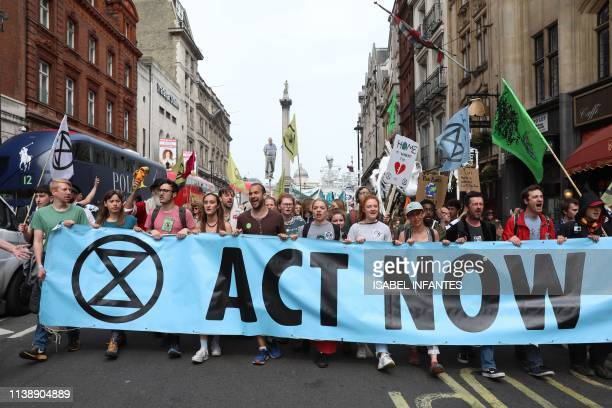 Climate change activists from the group Extinction Rebellion march down Whitehall as they protest in central London on April 24 2019