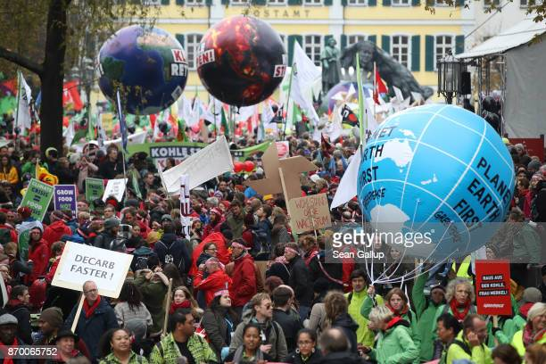 Climate change activists gather to march to protest against coal energy and other climaterelated issues on November 4 2017 in Bonn Germany The march...