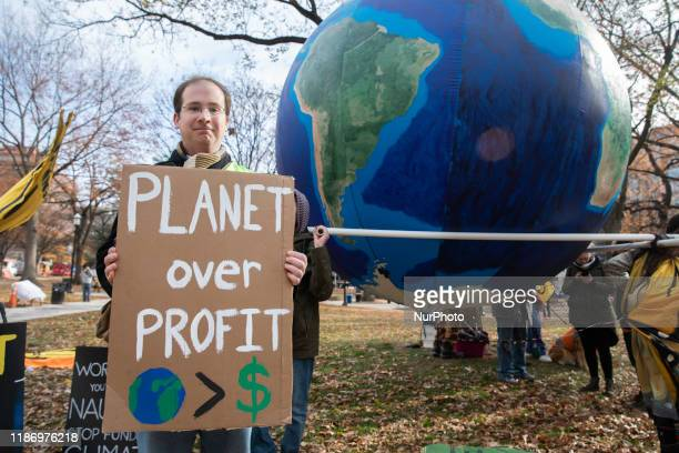 """Climate Change activists gathered to participate in a """"Fire Drill Fridays"""" climate change protest in Washington, D.C. On Friday, December..."""