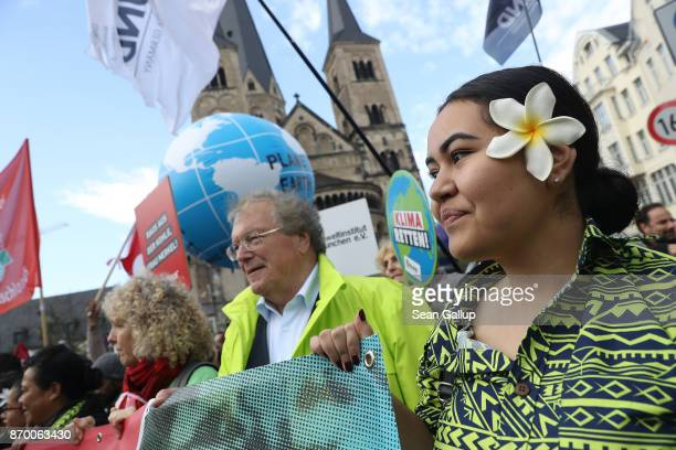 Climate change activists including a young woman from Samoa march to demonstrate against coal energy and other climaterelated issues on November 4...