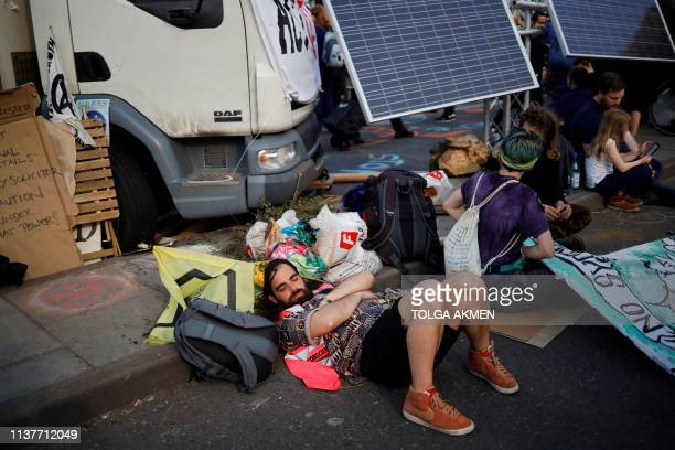Climate change activists lay on Waterloo Bridge on the third day of its blockade by environmental protest group Extinction Rebellion in London on...