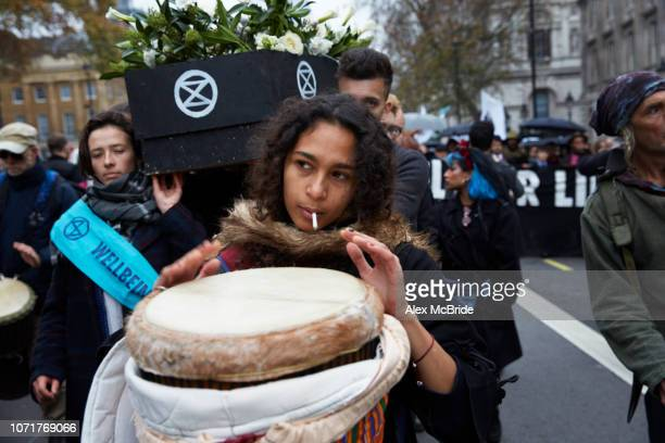 Climate change activists march a coffin symbolising the future of the planet if fossil fuel consumption continues from Parliament Square to...