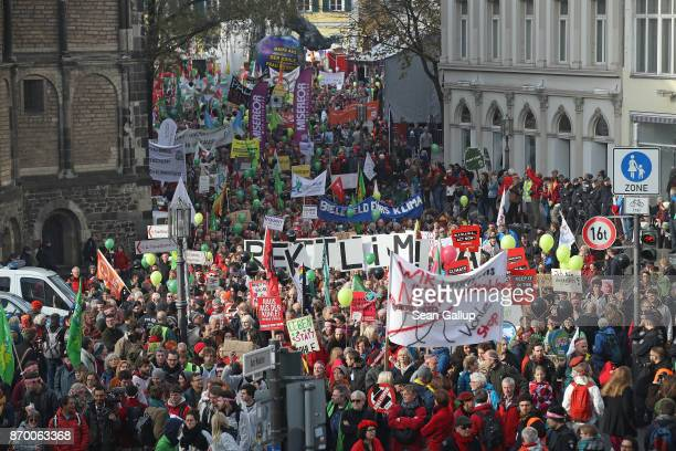 Climate change activists march to demonstrate against coal energy and other climaterelated issues on November 4 2017 in Bonn Germany The march...