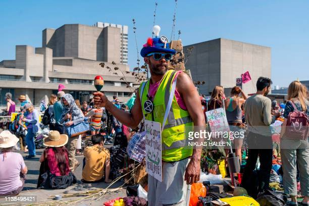 Climate change activists play music as the group continue to block the road on Waterloo Bridge in London on April 21 on the seventh day of an...