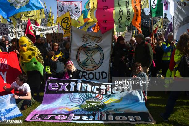 Climate change demonstrators gather in Parliament Square during climate change protests in central London on April 15 2019 Protests across the world...