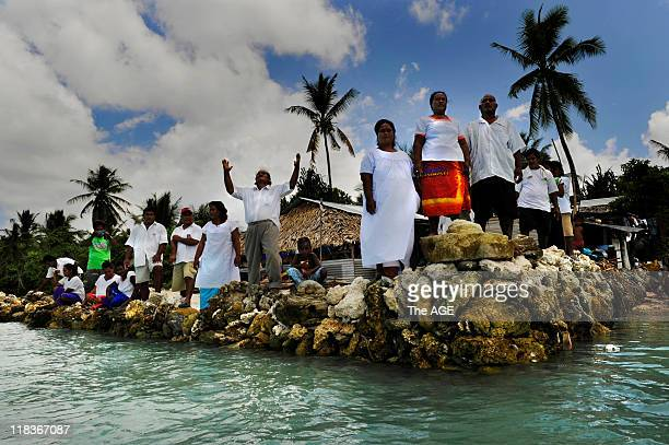 Climate change Kiribati Islands A congregation from a breakaway catholic sect that believes Jesus has risen again and will save Kiribati from rising...