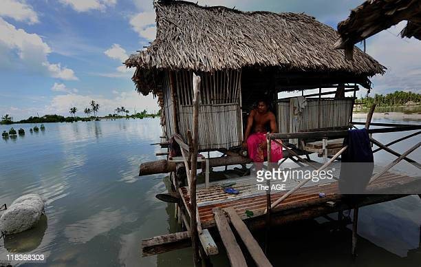 Climate change Kiribati Islands A man in his home in the relocated village Tebunginako on the Island of Abaiang His home used to be on a freshwater...