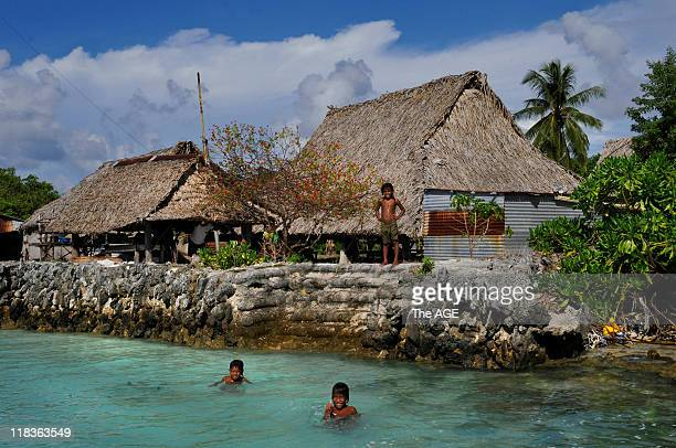 Climate change Kiribati Islands The village of Tebunginako on the Island of Abaiang has had to relocate because of rising seas and sand erosion The...