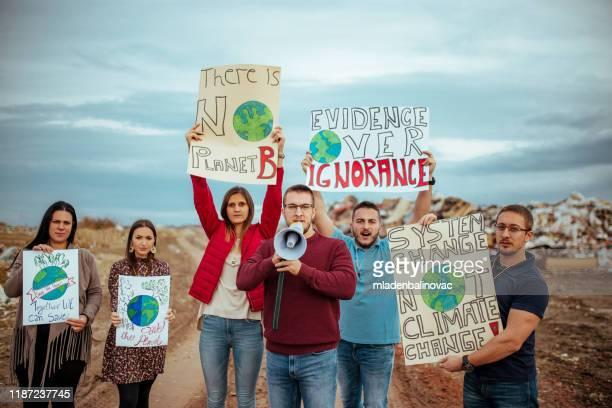 climate change protest - campaigner stock pictures, royalty-free photos & images