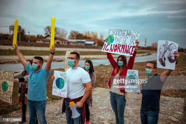 protesta contra el cambio climático - activista fotografías e imágenes de stock