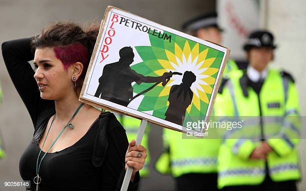 A climate change protester holds an antiBP banner in front of Shell petroleum's headquarters on September 1 2009 in London England Climate...