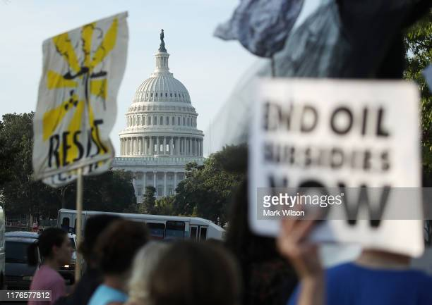 Climate change protesters block traffic during a protest to shut down D.C. On September 23, 2019 in Washington, DC. The protesters are for urging...