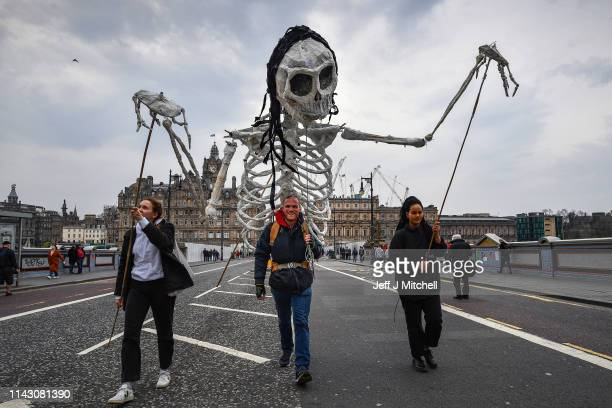 Climate change protesters holding up a skeleton puppet block one of the main roads into Edinburgh's city centre on April 16 2019 in Edinburgh...