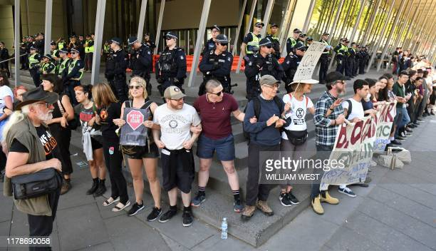 Climate change protesters link arms as they attempt to blockade the International Mining and Resources Conference being held in Melbourne on October...