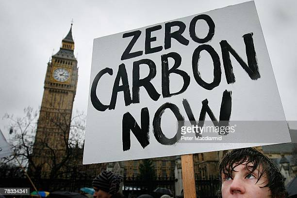 Climate change protestor walks near Parliament on December 8, 2007 in London. Demonstrators are gathering in more than 50 countries around the world....