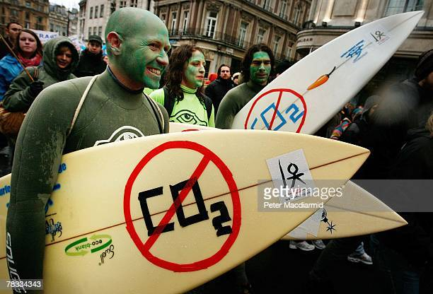 Climate change protestors carry surf boards near Trafalgar Square on December 8 2007 in London Demonstrators are gathering in more than 50 countries...