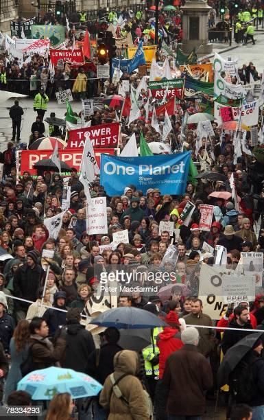 Climate change protestors march near Trafalgar Square on December 8 2007 in London Demonstrators are gathering in more than 50 countries around the...