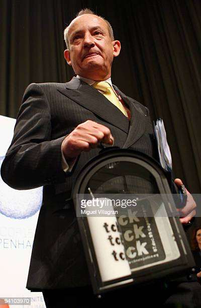 Climate Chief Yvo de Boer holds a candle in his hand that he got handed over from the environmentalist group TckTckTck during the first day of United...