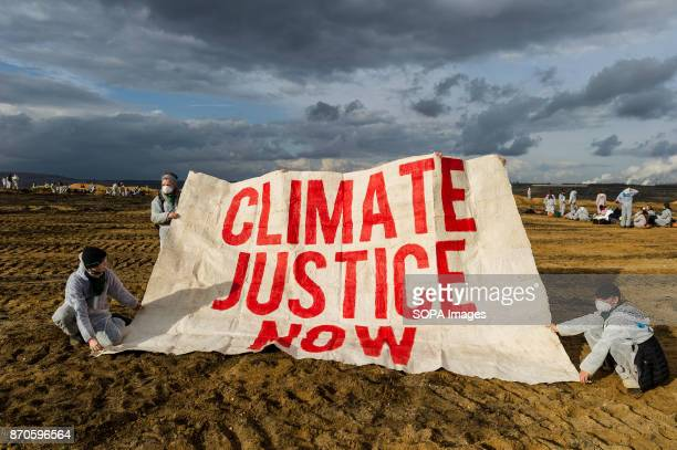 'Climate justice now' is written on a banner of activists in the coal pit Approximately 2500 activists invaded the pit of the lignite open cast mine...
