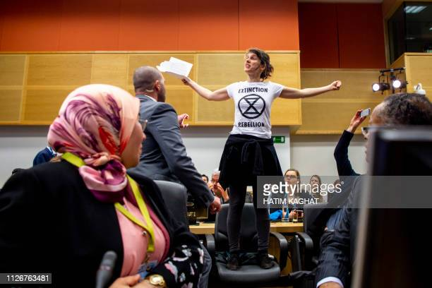 A climate protester climbs on a chair during a conference on climate change and the state of the oceans organised by minister Marghem Tuesday 19...