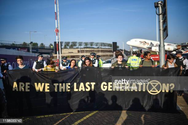 Climate protestors hold a demo outside Heathrow Airport on April 19 2019 in London England The climate change activism group Extinction Rebellion...