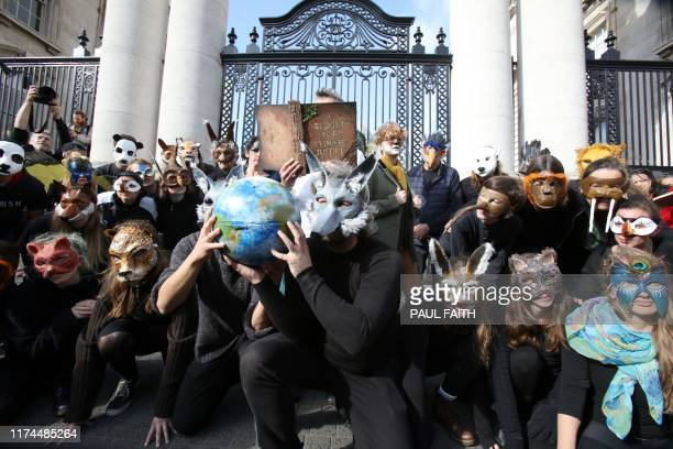 Climate protestors protest outside Government Buildings as Irish Finance Minister Paschal Donohoe presents his Budget 2020 to parliament in Dublin on...