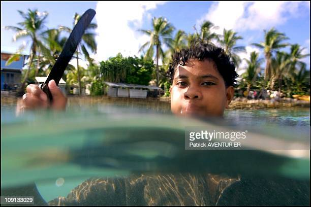 Climate Warming And Water Rise Threaten Pacific Nation Of Tuvalu On January 4Th 2002 In Funafuti Tuvalu Young Fisherman In The Lagoon Of Funafuti