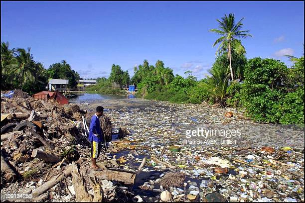 Climate Warming And Water Rise Threaten Pacific Nation Of Tuvalu On January 4Th 2002 In Funafuti Tuvalu During Wwii The Americans Dug Hole For The...
