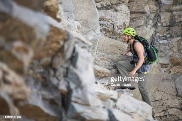 Climber ascends headwall of Douglas Peak, British Columbia.