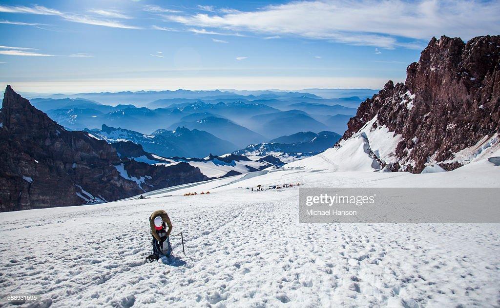A climber ascends Mount Rainier in Mount Rainier National Park, Washington, USA. : Stock Photo