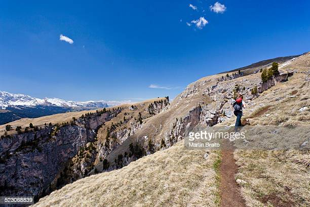 Climber at the end of the Stevia climbing route in Vallunga near Selva, overlooking Sciliar Mountain, Val Gardena, Alto Adige, Italy, Europe