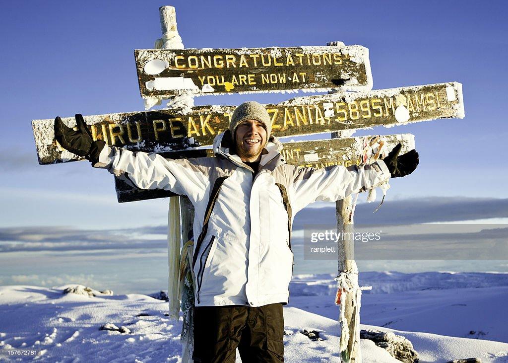 Climber at the Top of Mount Kilimanjaro : Stockfoto