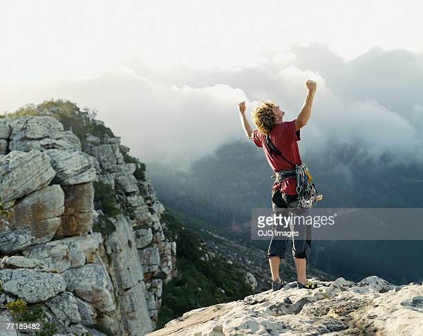 A climber at the top of the mountain victorious